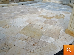 Umber travertine in the foreground - Marrone to the back left and Argent in the upper right