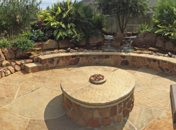 natural stone, stone patio, fire pit, stone fire pit, outdoor living, seating area, stone yard houston, moss rock, flagstone